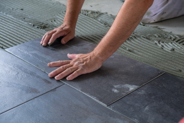 Gresham Worker installing ceramic floor tiles